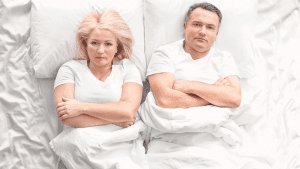 Divorcing couple laid in bed